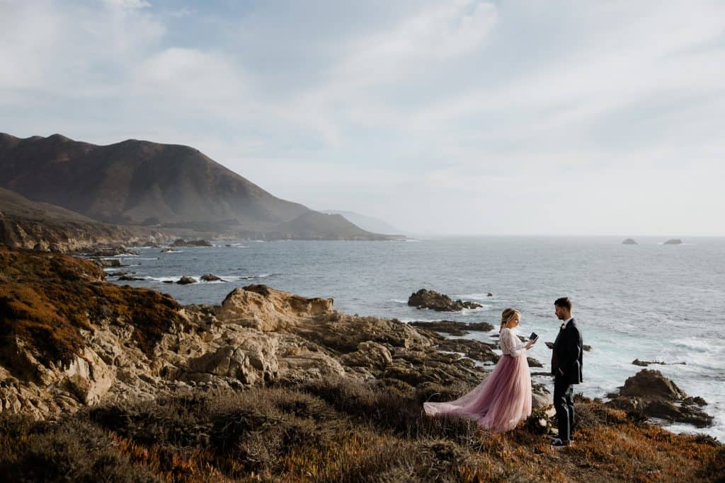 Ceremony during a Big Sur Elopement under the sun facing the Pacific