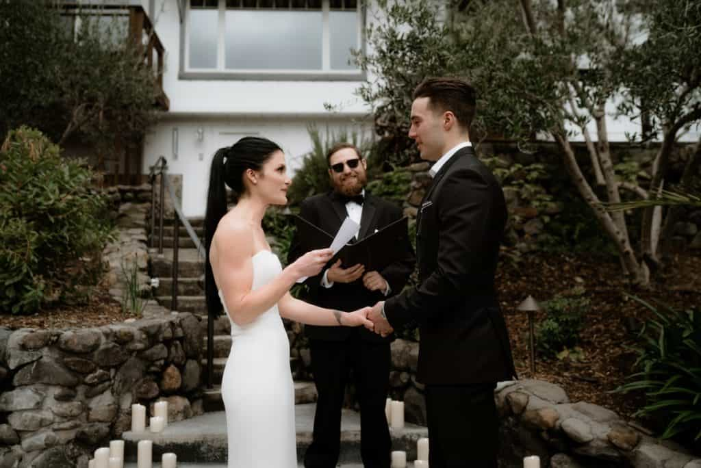 Exchanging vows during a Backyard micro wedding in Napa