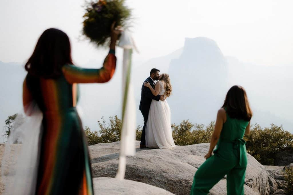 Yosemite micro wedding first kiss