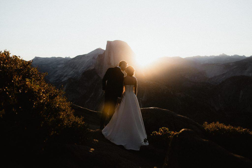 Catching the sunrise at Glacier Point Yosemite for this summer elopement